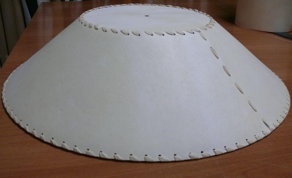 Tronco di cono cucito con pelle
